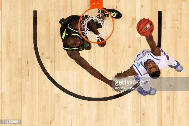 Michael Kidd-Gilchrist of the Kentucky Wildcats shoots over Quincy Acy of the Baylor Bears during the 2012 NCAA Men's Basketball South Regional Final...
