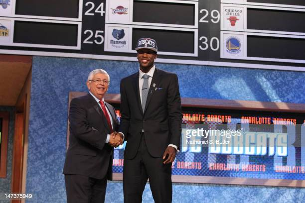 Michael KiddGilchrist shakes hands with NBA Commissioner David Stern after being selected number two overall by the Charlotte Bobcats during the 2012...
