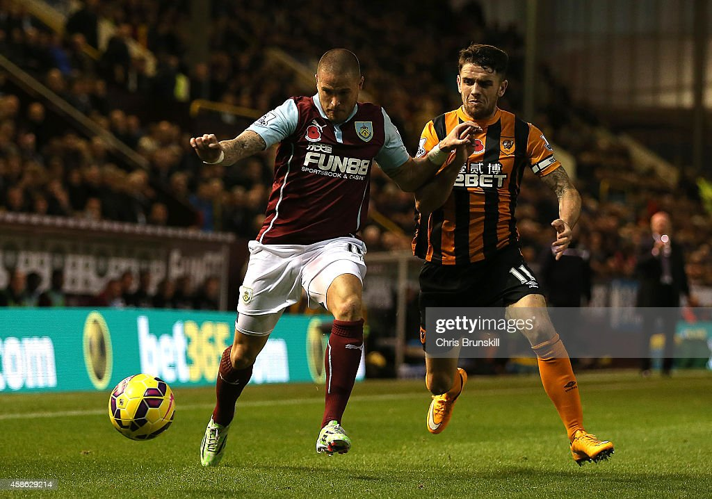 Michael Kightly of Burnley battles with Robbie Brady of Hull City during the Barclays Premier League match between Burnley and Hull City at Turf Moor on November 08, 2014 in Burnley, England.
