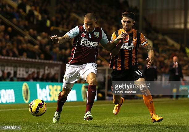 Michael Kightly of Burnley battles with Robbie Brady of Hull City during the Barclays Premier League match between Burnley and Hull City at Turf Moor...