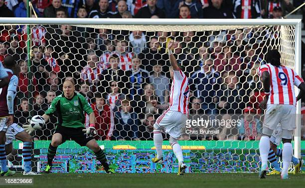 Michael Kightly of Stoke City scores his team's first goal to make the score 11 during the Barclays Premier League match between Stoke City and Aston...