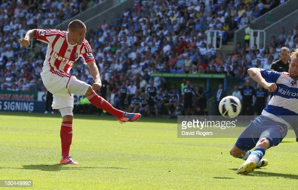 Michael Kightly of Stoke City scores the opening goal during the Barclays Premier League match between Reading and Stoke City at Madejski Stadium on...