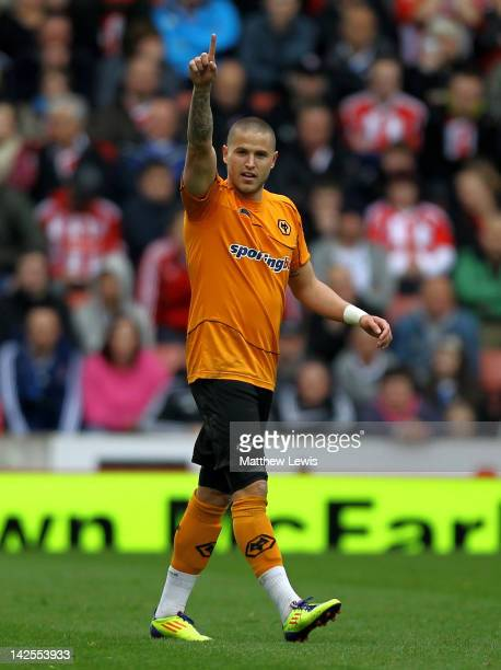 Michael Kightly of Wolverhampton Wanderers celebrates scoring the opening goal during the Barclays Premier League match between Stoke City and...