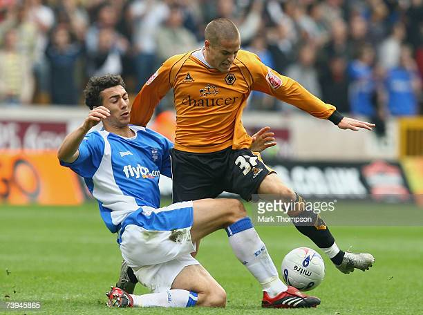 Michael Kightly of Wolves tangles with Stephen Kelly of Birmingham City during the Coca Cola Championship match between Wolverhampton Wanderers and...