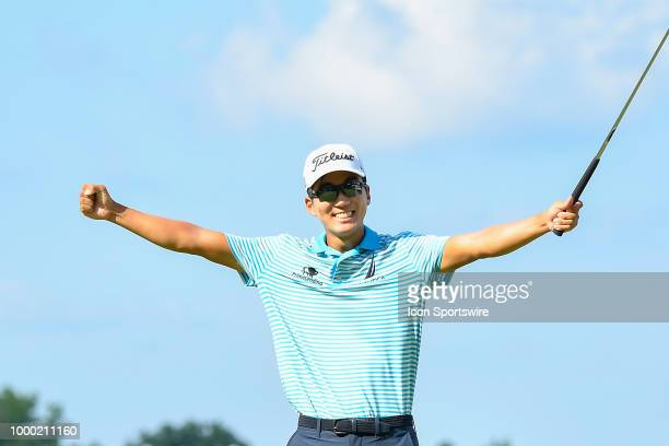 Michael Kim celebrates after winning the John Deere Classic on July 15 2018 at the TPC Deere Run in Silvis Illinois