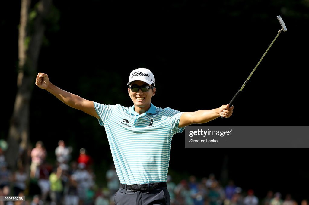 Michael Kim celebrates on the 18th green after winning the John Deere Classic at TPC Deere Run on July 15, 2018 in Silvis, Illinois.
