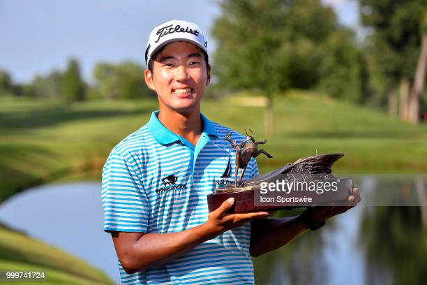 Michael Kim celebrates with the trophy after winning the John Deere Classic during the final round of the John Deere Classic on July 15 2018 at the...