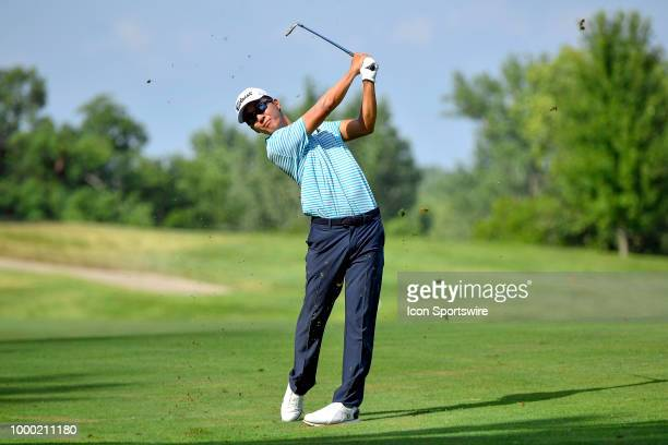 Michael Kim hits his approach shot on the 18th hole during the final round of the John Deere Classic on July 15 2018 at the TPC Deere Run in Silvis...