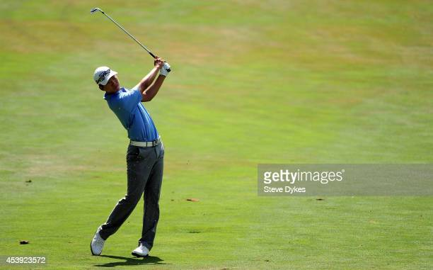 Michael Kim hits his approach shot on the sixth hole during the first round of the WinCo Foods Portland Open presented by Kraft at Witch Hollow at...