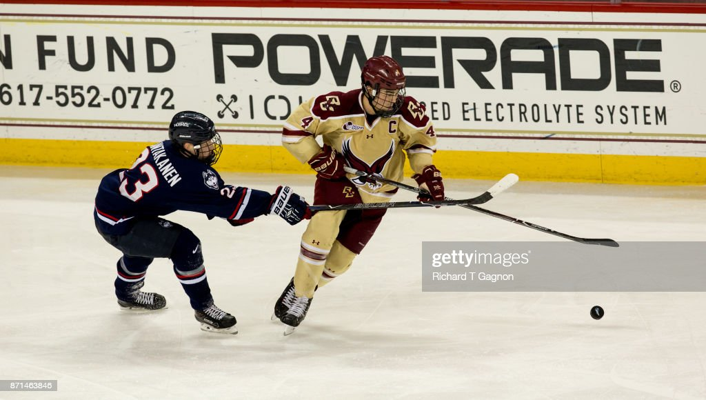 Michael Kim #4 of the Boston College Eagles controls the puck away from Kasperi Ojantakanen #23 of the Connecticut Huskies during NCAA hockey at Kelley Rink on November 7, 2017 in Chestnut Hill, Massachusetts. The Eagles won 2-1.