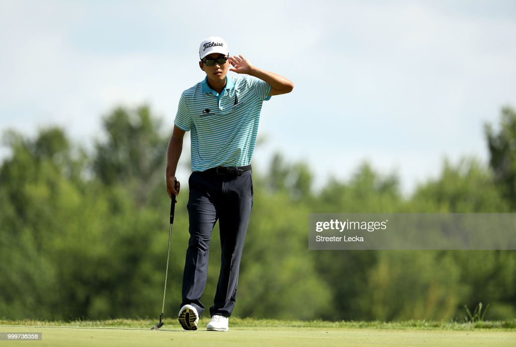 Michael Kim reacts after making a putt on the 16th green during the final round of the John Deere Classic at TPC Deere Run on July 15, 2018 in Silvis, Illinois.