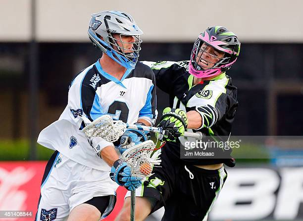 Michael Kimmel of the New York Lizards defends against Jake Bernhardt of the Ohio Machine during their Major League Lacrosse game at Shuart Stadium...