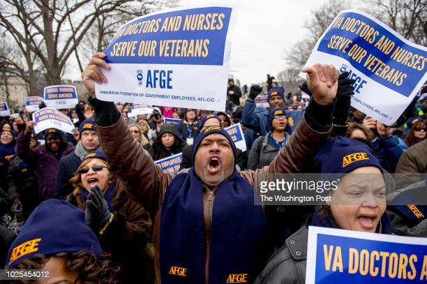 Michael King of Houston Texas center cheers during an American Federation of Government Employees rally on Capitol Hill on February 10 2015 in...
