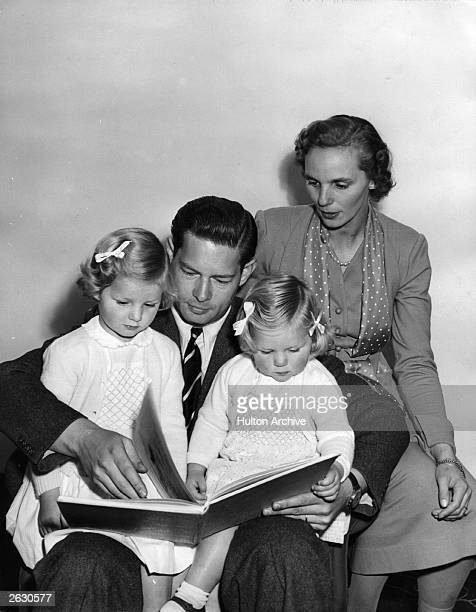 Michael King of Romania with his wife Princess Anne and his daughters Princess Helen and Princess Margaret He is reading a bedtime story