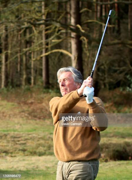 Michael King the former European Ryder Cup player and long term Sunningdale member plays a shot during Nick Edmund's GlobalGolf4Cancer World Cancer...