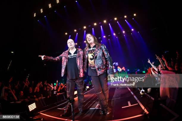 Michael Kiske and Andi Deris of the German band Helloween perform live on stage during a concert at the Tempodrom on December 4 2017 in Berlin Germany