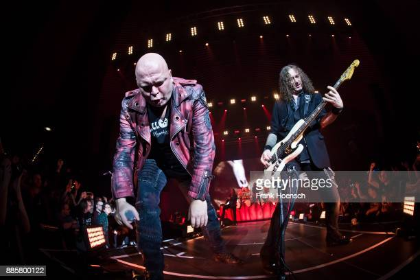 Michael Kiske and Markus Grosskopf of the German band Helloween perform live on stage during a concert at the Tempodrom on December 4 2017 in Berlin...