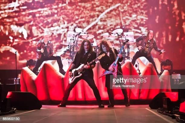 Michael Kiske Markus Grosskopf Daniel Loeble Sascha Gerstner and Andi Deris of the German band Helloween perform live on stage during a concert at...