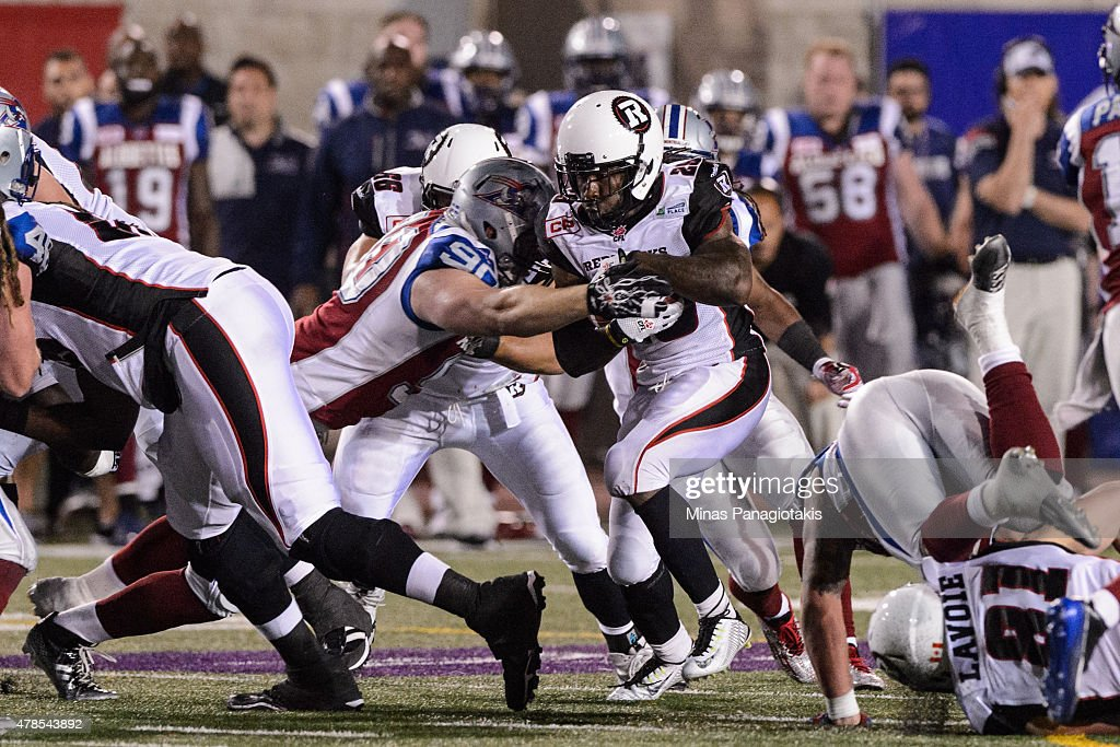 Michael Klassen #90 of the Montreal Alouettes goes for the tackle on Chevon Walker #29 of the Ottawa Redblacks during the CFL game at Percival Molson Stadium on June 25, 2015 in Montreal, Quebec, Canada. The Ottawa Redblacks defeated the Montreal Alouettes 20-16.