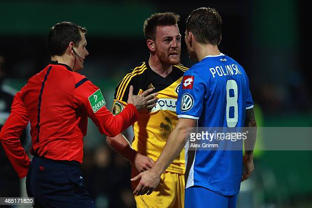 Michael Klauss of Aalen argues with Eugen Polanski of Hoffenheim during the DFB Cup Round of 16 match between VfR Aalen and 1899 Hoffenheim at Scholz...