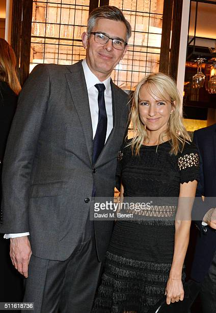 Michael Kliger and Heidi Hoelzer attend as mytheresacom and Burberry celebrate the new MYT Woman at Thomas's on February 21 2016 in London England