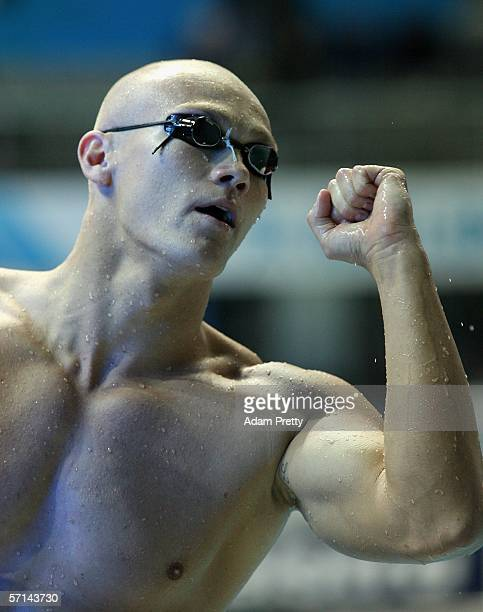 Michael Klim of Australia pumps the air upon finishing his leg of his team's Gold winning swim during the Men's 4 x 100m Medley Relay during the...