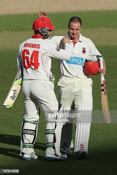 Michael Klinger and Phillip Hughes of the Redbacks leave the field at the end of play on day two of the Sheffield Shield match between the Redbacks...