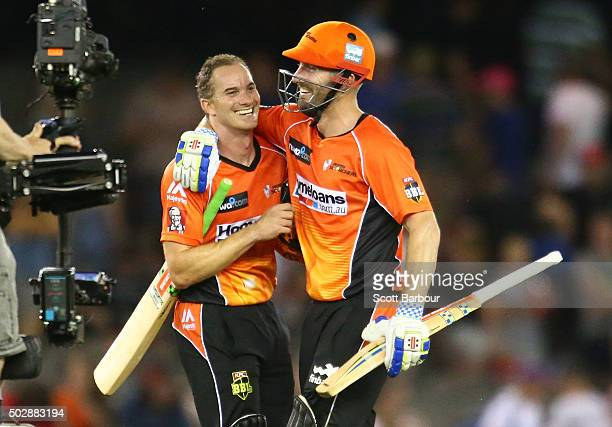 Michael Klinger and Shaun Marsh of the Scorchers celebrate after the winning runs were hit to win the Big Bash League match between the Melbourne...