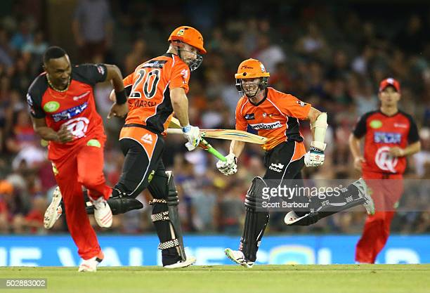 Michael Klinger and Shaun Marsh of the Scorchers run between the wickets during the Big Bash League match between the Melbourne Renegades and the...