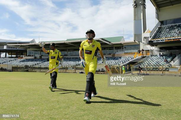 Michael Klinger and Shaun Marsh of the Warriors walk out to bat during the JLT One Day Cup match between Victoria and Western Australia at WACA on...