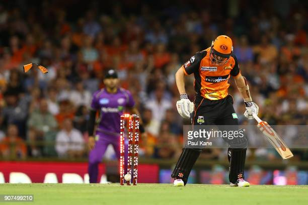 Michael Klinger of the Scorchers looks down at the stumps after being bowled by Jofra Archer of the Hurricanes during the Big Bash League match...