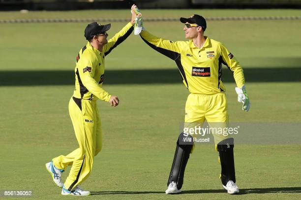 Michael Klinger of the Warriors celebrates after taking a catch to dismiss Sam Harper of the Bushrangers during the JLT One Day Cup match between...