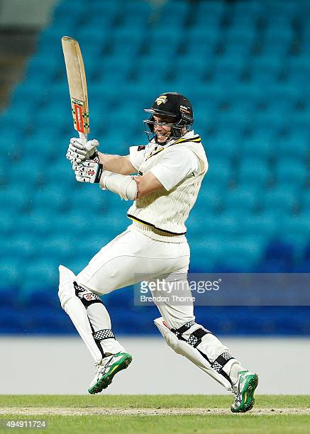 Michael Klinger of Western Australia plays a pull shot during day three of the Sheffield Shield match between Tasmania and Western Australia at...