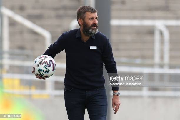 Michael Köllner, head coach of 1860 München looks on during the 3. Liga match between TSV 1860 München and Bayern München II at Stadion an der...