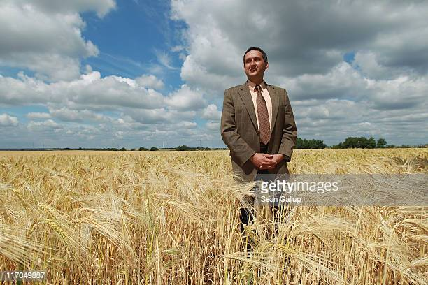 Michael Knape mayor of Treuenbrietzen which also includes the village of Feldheim poses for a portrait in a field of barley on June 20 2011 in...