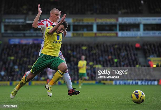 Michael Knightly of Stoke City fouls Robert Snodgrass of Norwich City during the Barclays Premier League match between Norwich City and Stoke at...