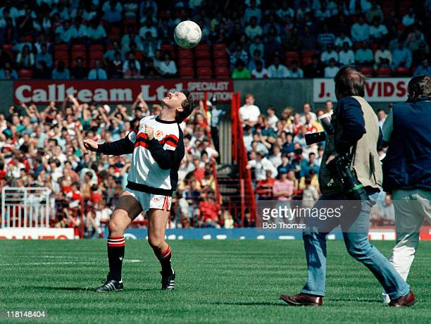 Michael Knighton demonstrating his ball skills on the pitch at Old Trafford after agreeing to buy Manchester United prior to United's First Division...