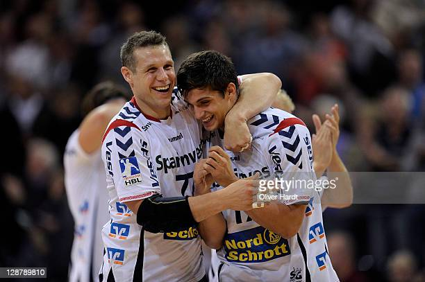 Michael Knudsen and Petar Djordjic of Flensburg celebrate after the Toyota HBL match between SG FlensburgHandewitt and HSG Wetzlar at Campus hall on...