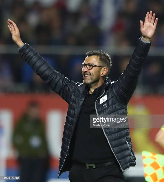 Michael Koellner head coach of Nuernberg celebrates his teams victory at the full time whistle during the Second Bundesliga match between Holstein...