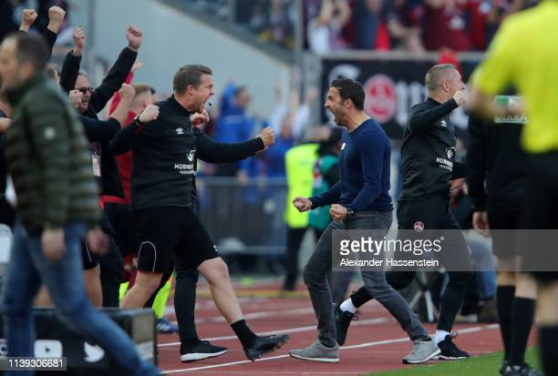 Michael Koellner, Manager of Nuernberg celebrates his sides third goal during the Bundesliga match between 1. FC Nuernberg and FC Augsburg at...
