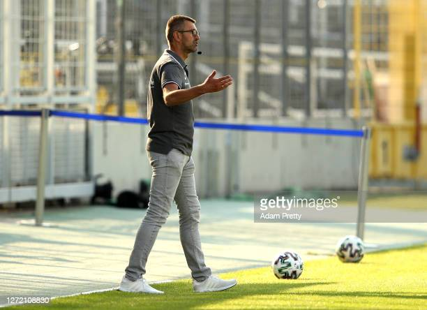 Michael Koellner of TSV 1860 Muenchen gives his team instructions during the DFB Cup first round match between TSV 1860 Muenchen and Eintracht...