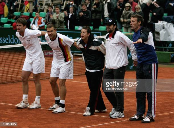 Michael Kohlmann Alexander Waske Philipp Kohlschreiber Nicoals Kiefer and head coach Patrick Kuehnen of Germany celebrate the 64 67 and 105 victory...