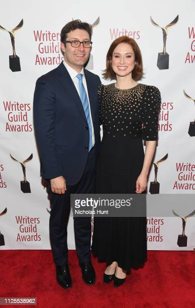 Michael Koman and Ellie Kemper pose backstage during the 71st Annual Writers Guild Awards New York ceremony at Edison Ballroom on February 17, 2019...