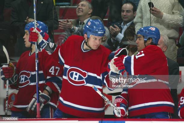 Michael Komisarek and Francis Bouillon of the Montreal Canadiens celebrate at the bench during their NHL game against the Tampa Bay Lightning at Bell...