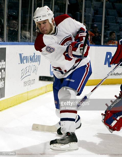 Michael Komisarek of the Montreal Canadiens clears the puck against the New York Islanders during their game on December 7, 2006 at Nassau Coliseum...