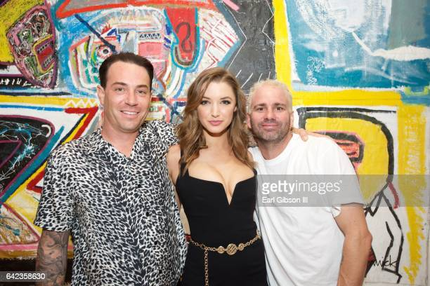 Michael Konior Alyssa Arce and artist Danny Mannick attend the Power To The Planet Exhibition Opening at De Re Gallery on February 16 2017 in West...