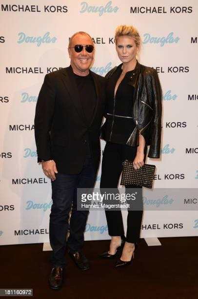 Michael Kors and Alexandra Richards attend the opening by designer Michael Kors of Fragrance Beauty Corner at Douglas on September 19 2013 in Munich...