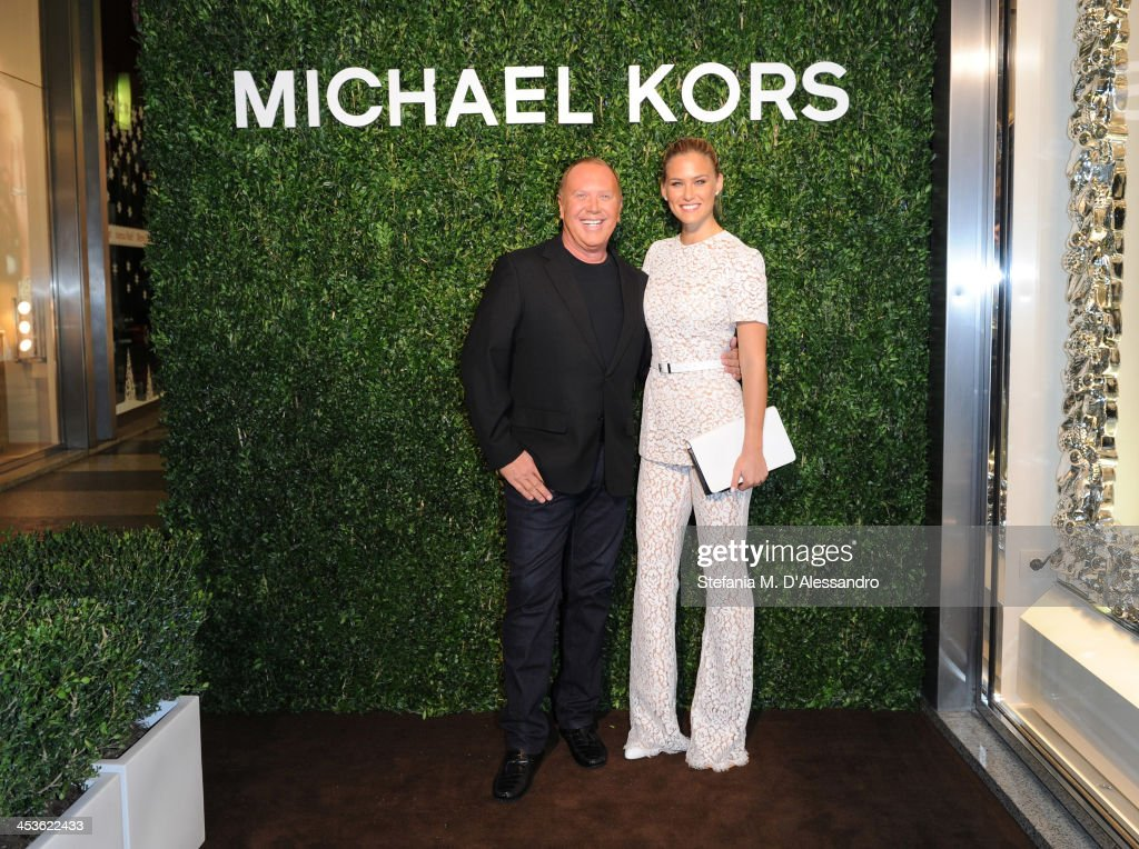 Michael Kors and Bar Refaeli attend Michael Kors To celebrate Milano opening on December 4, 2013 in Milan, Italy.