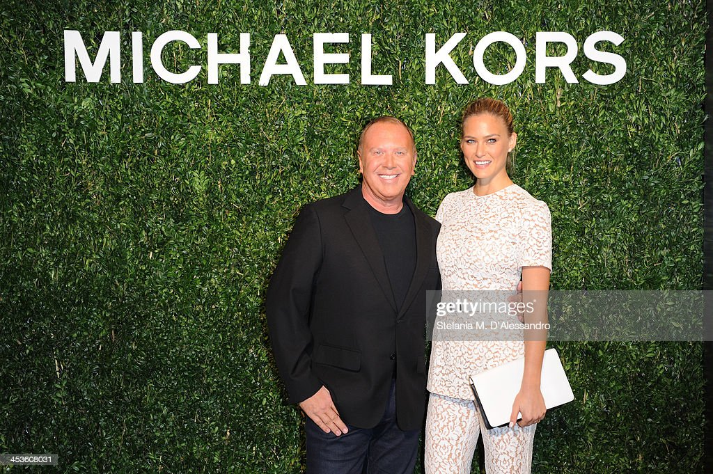Michael Kors and Bar Refaeli attend the Michael Kors to Celebrate Milano opening on December 4, 2013 in Milan, Italy.