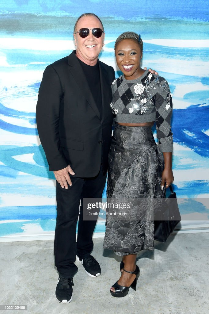 Michael Kors (L) and Cynthia Erivo pose backstage during the Michael Kors Collection Spring 2019 Runway Show at Pier 17 on September 12, 2018 in New York City.